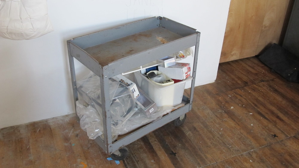 Light-Grey Rusted Tool Cart with Wheels $60