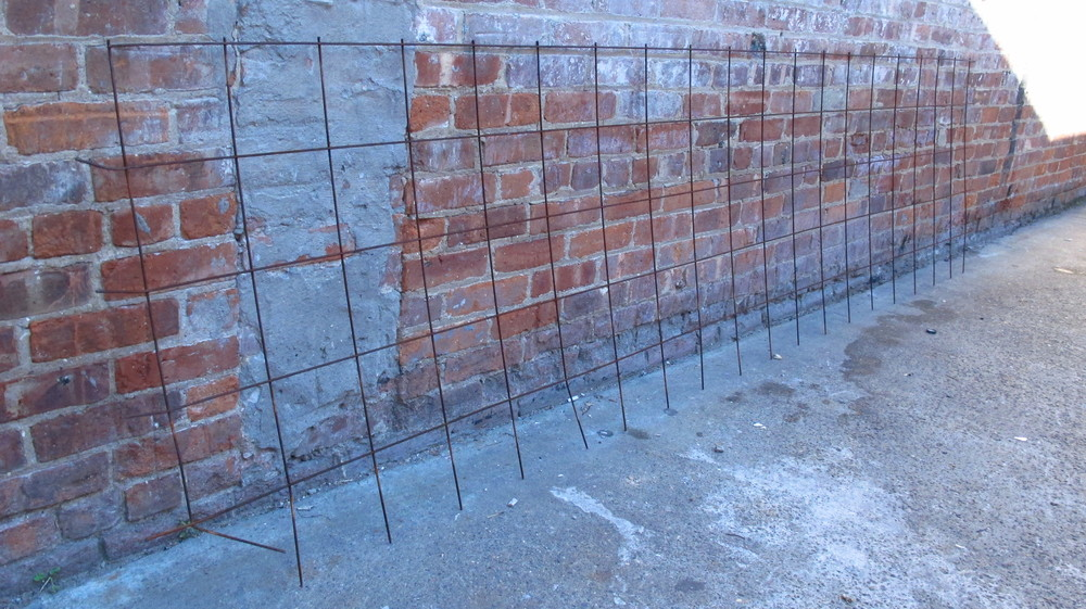 Thin and Narrow Rusted Fencing