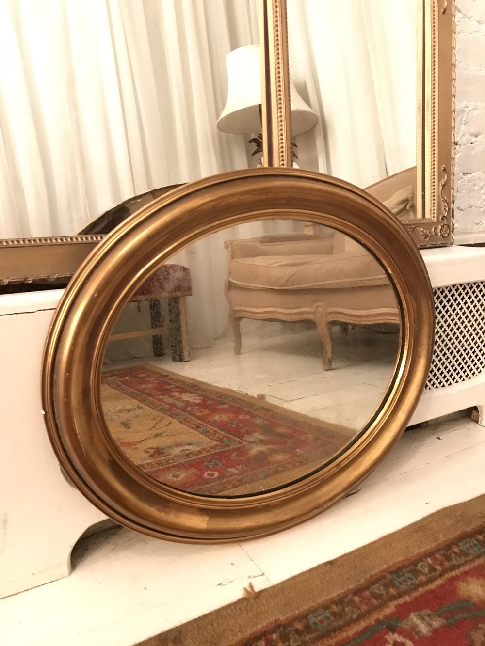 Gold framed oval mirror