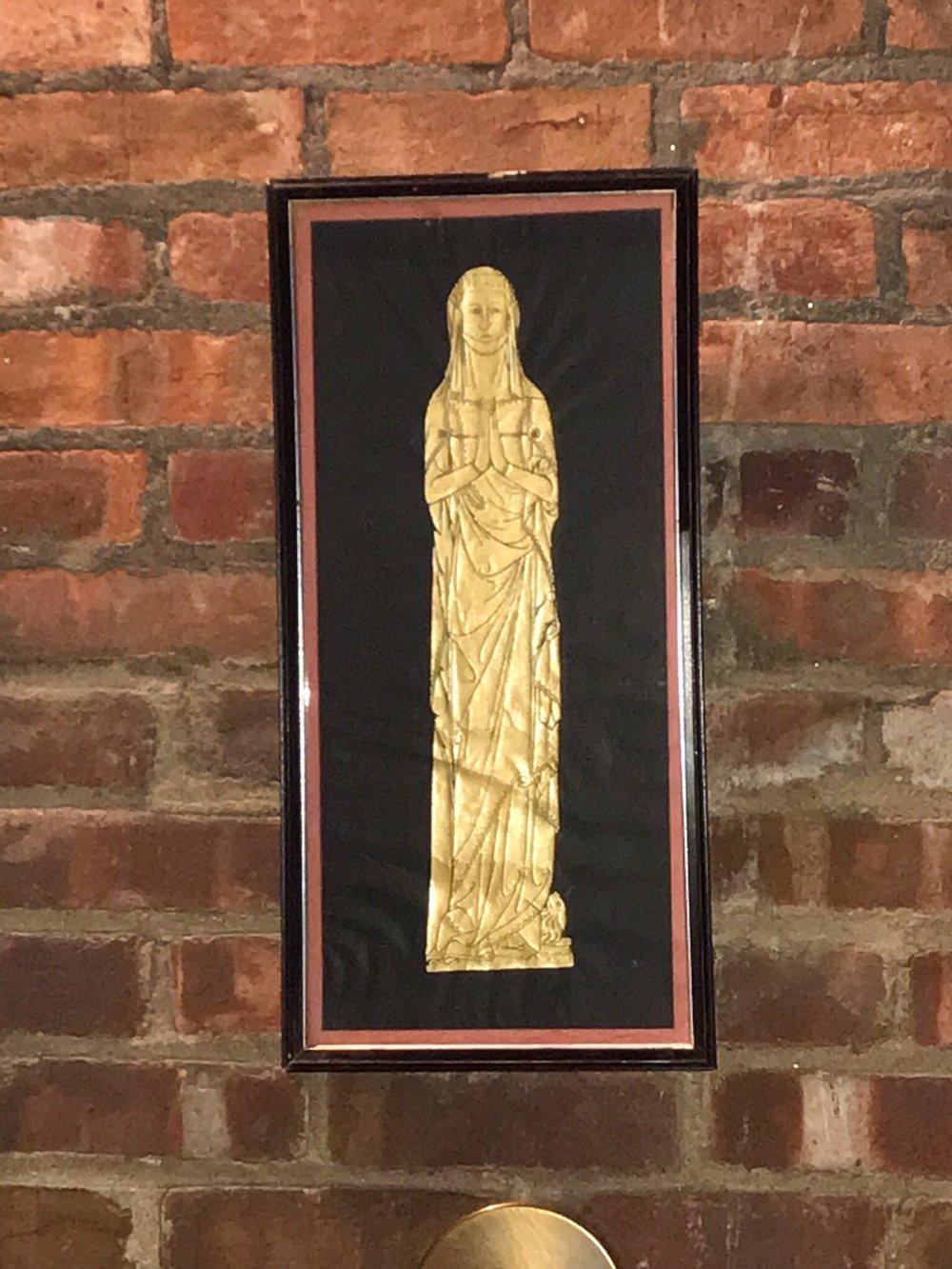 Framed golden figure painting