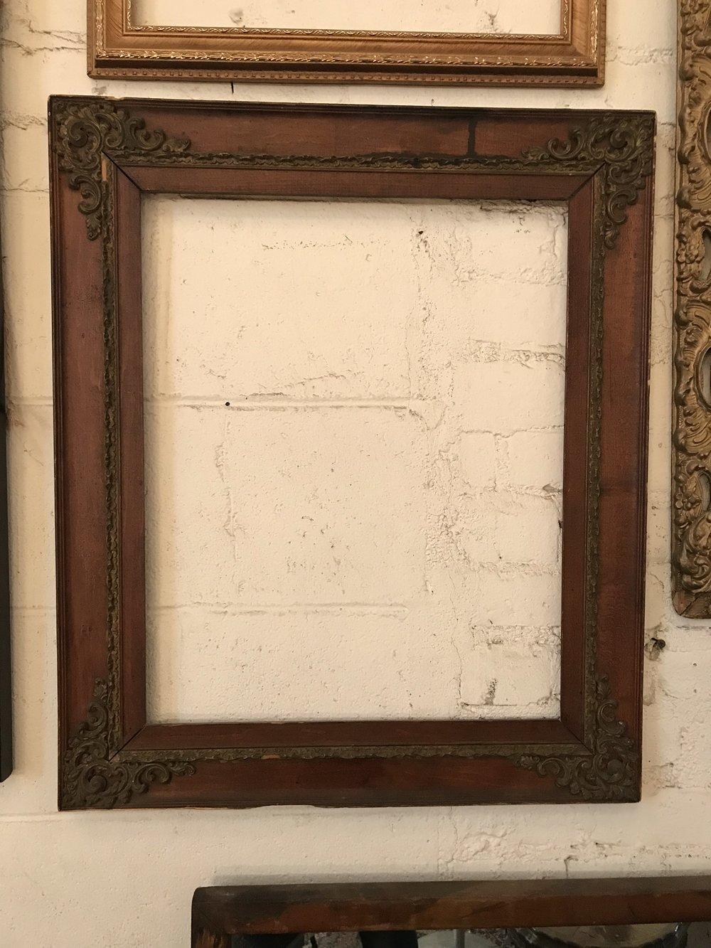 Ornate corners dark wood frame