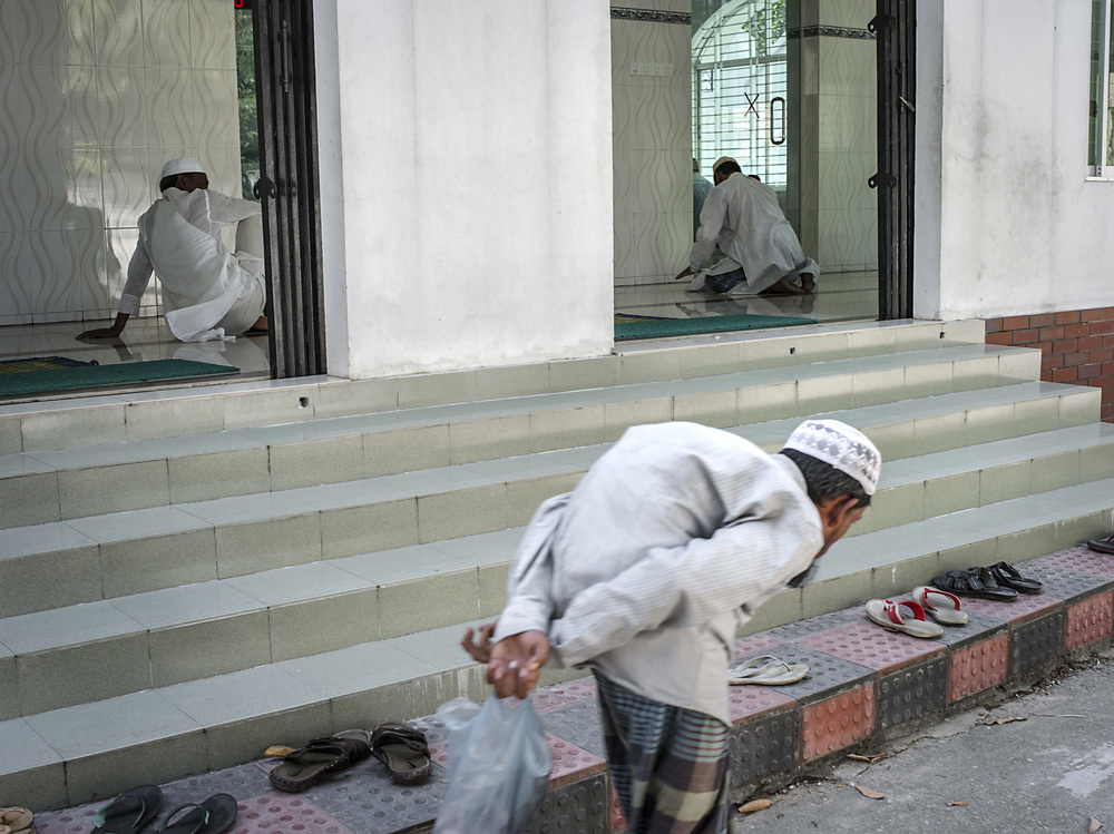 A man outside a mosque in Sylet.