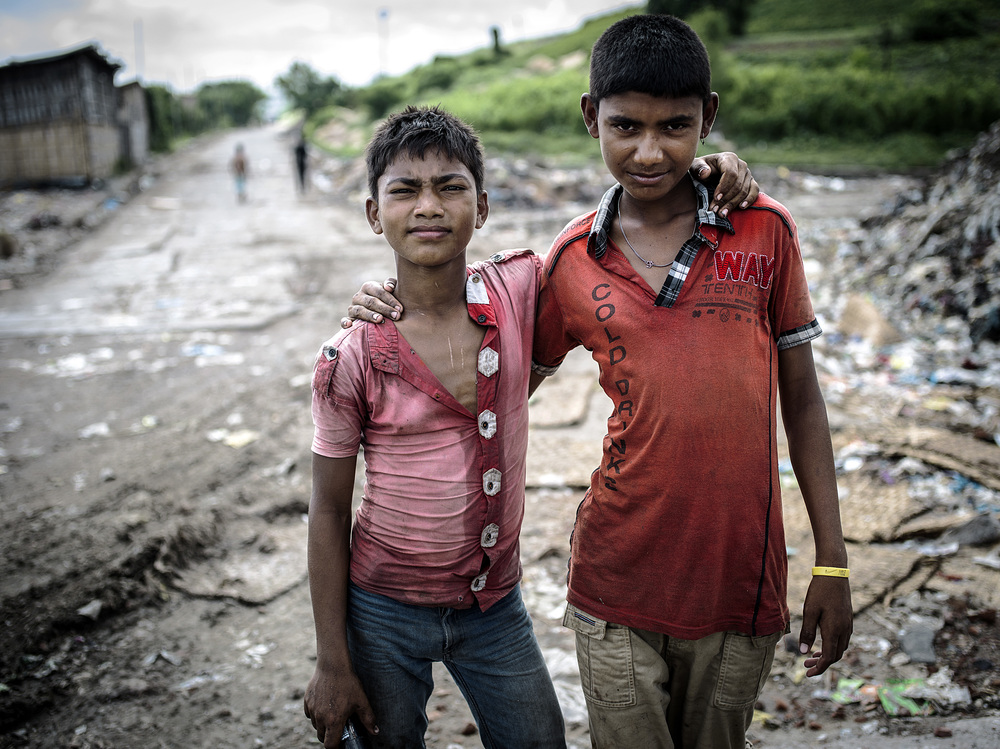 Two young boys pose at Matuail Landfill in Dhaka, Bangladesh.