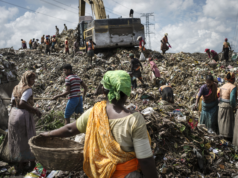 Informal recyclers  at Matuail Landfill in Dhaka, Bangladesh.