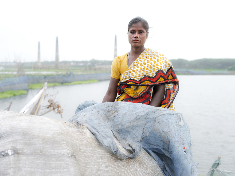 A woman informing working at Aminbazar Sanitary Landfill, Dhaka.