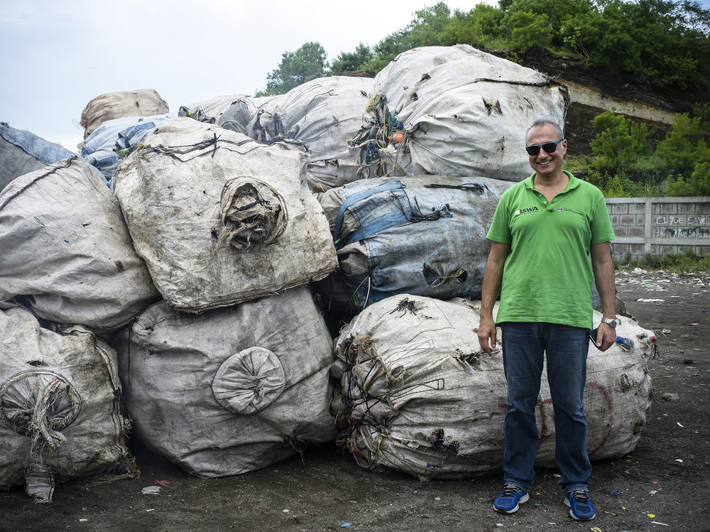 Antonis standing by the material collected and sorted by the families from La Chureca.