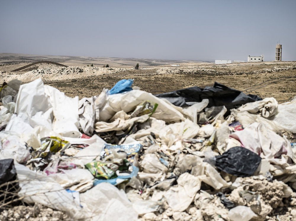 In the foreground you can see trash from Al Ekaider. In the distance you can see Syria, the border and their one dumpsite that is not in operation anymore. The workers say they have seen bombs explode there regularly.