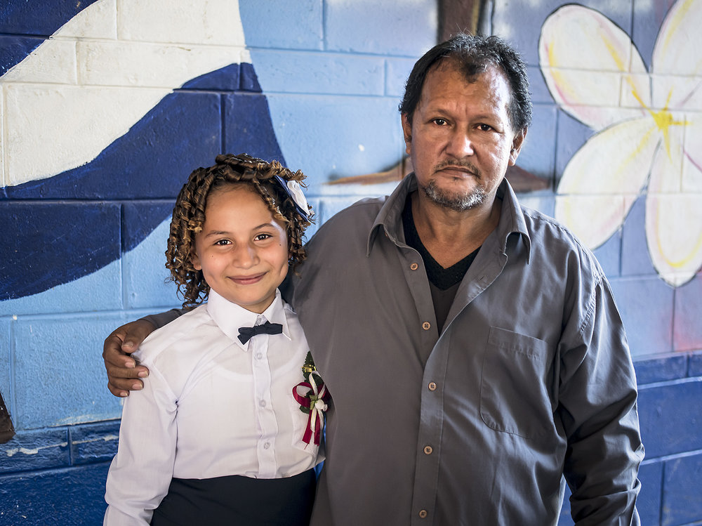 Carolina finishes primary school and is pictured with her dad.