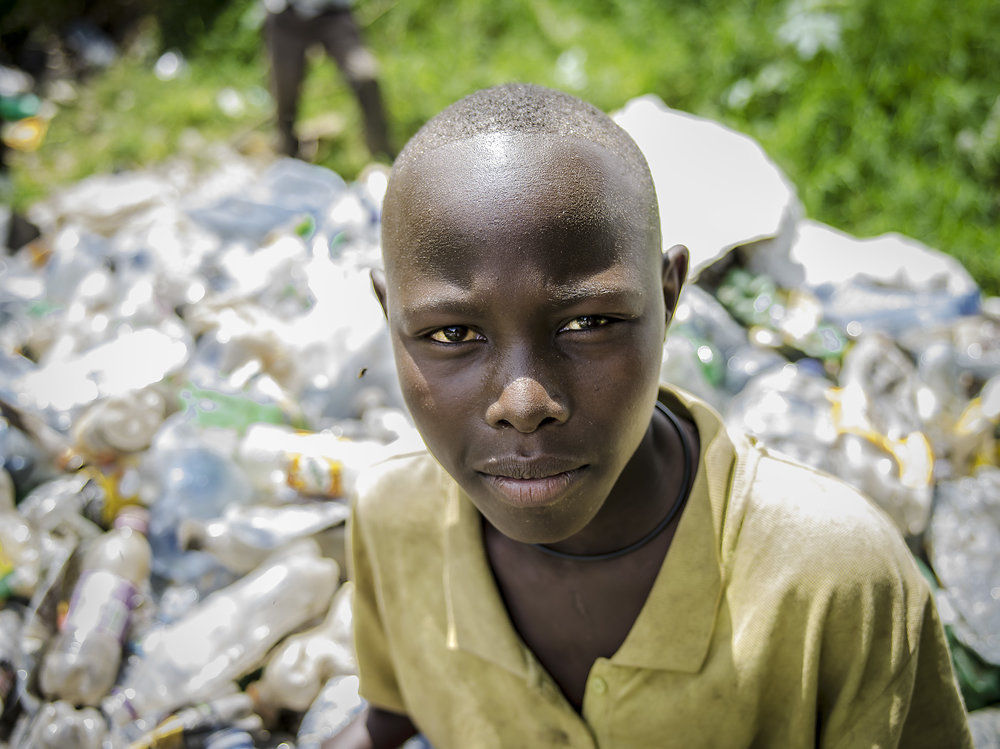 A boy recycling at the Masaka dumpsite.