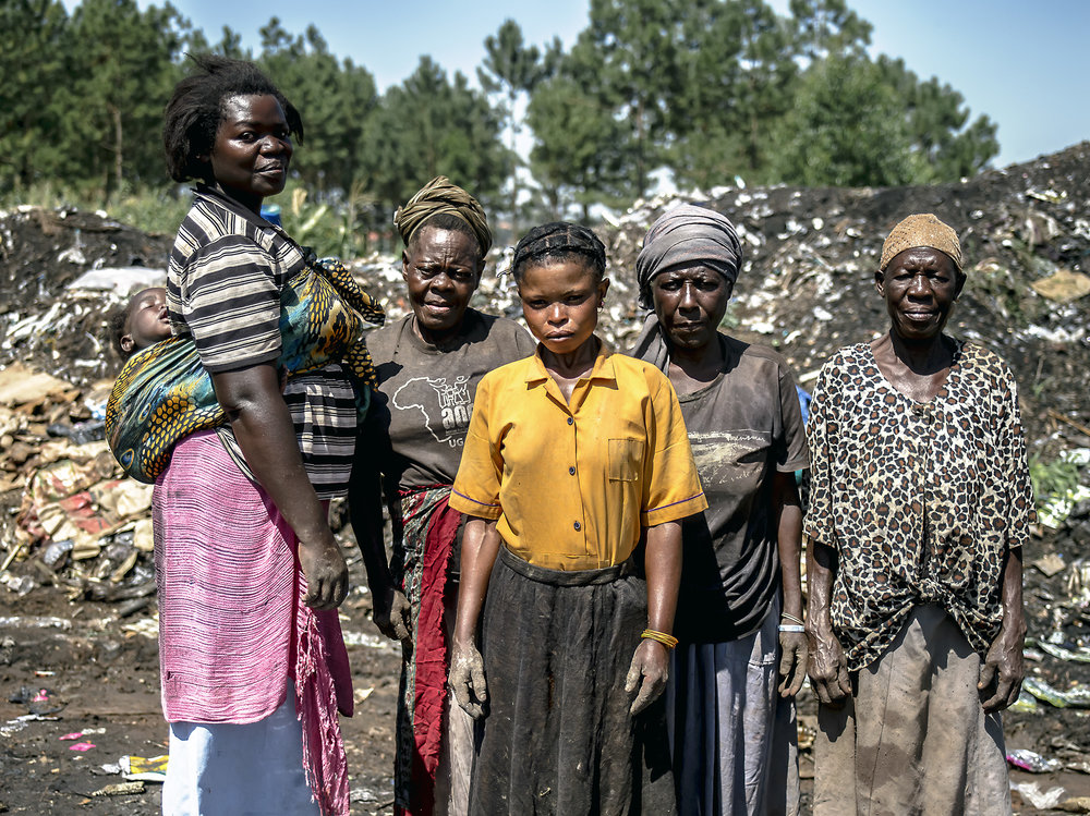 Informal recyclers come to work at the Jinja dumpsite as well, like this group of women.