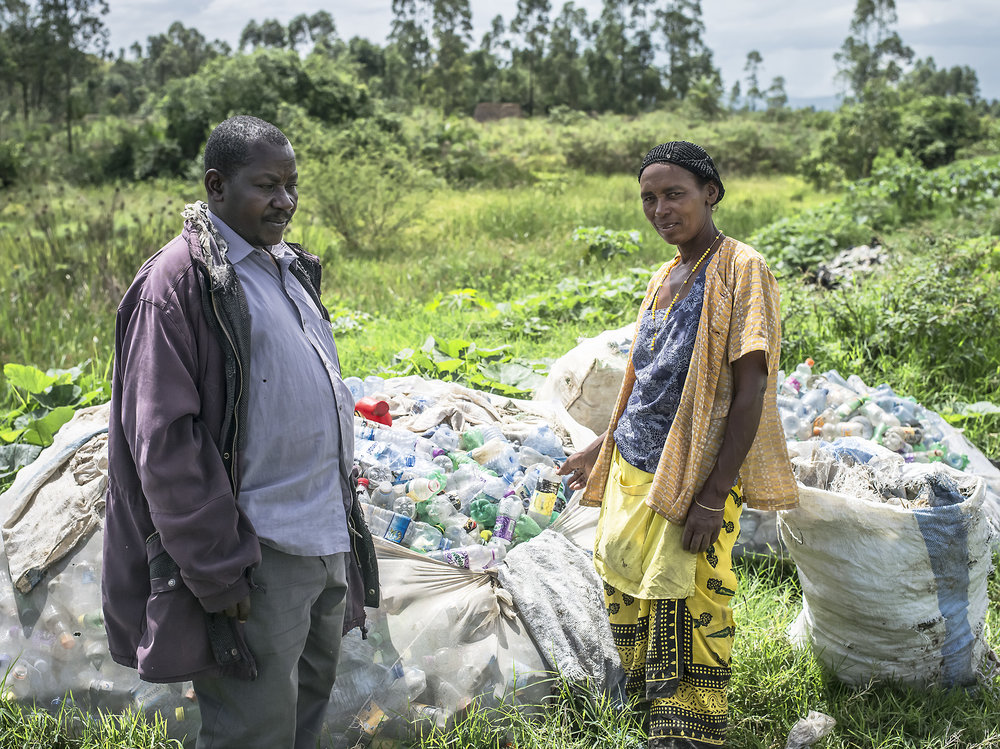 Chairman of Kabwohe and Tukahairwa Gauda. Gauda recycles in Mbarara, but now also takes a bus to work in this area because trash was being thrown into the local swamp. She does not make a lot of profit because of the transportation cost. She sells her materials to a Chinese company. Kabwohe
