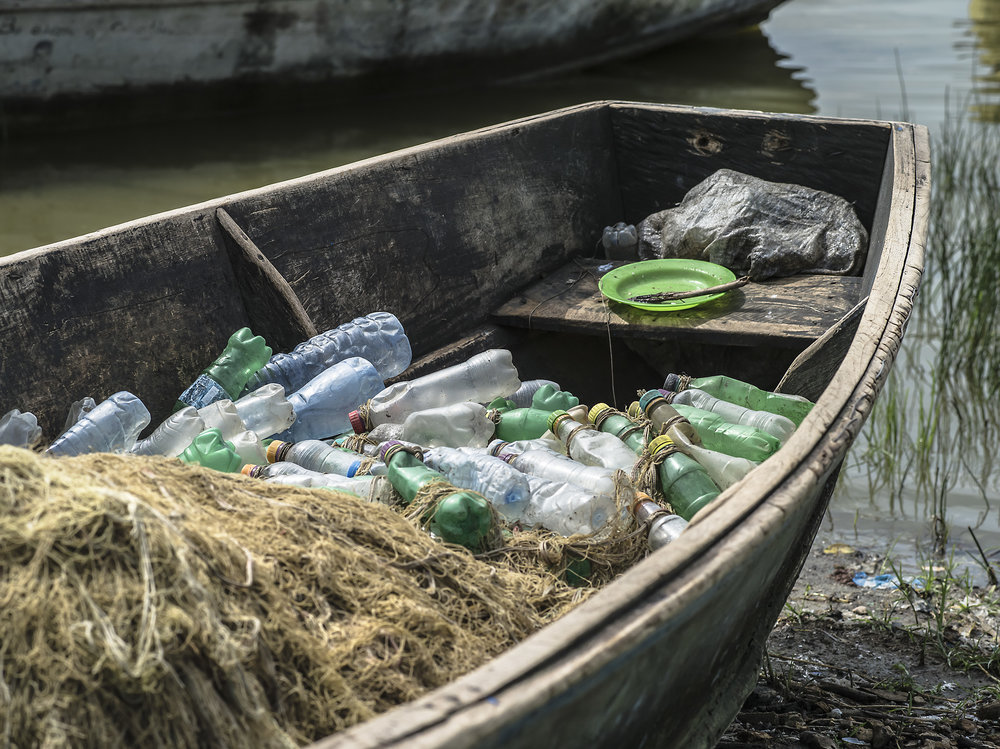 Fishermen use recycled bottles as bobbers. Katwe Kabatoro.