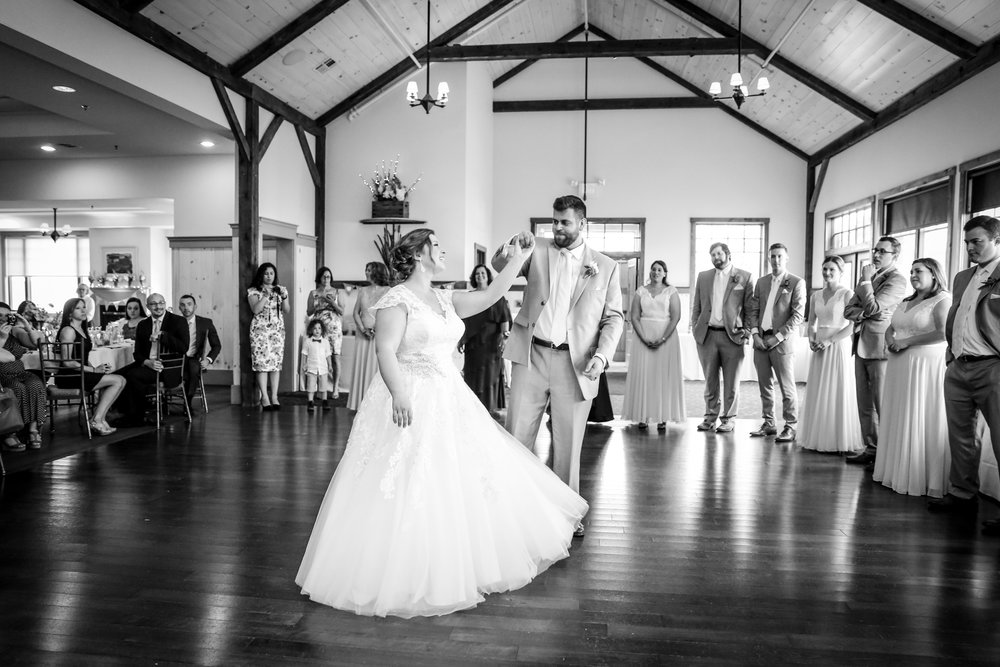 Our repurposed barn frame is the perfect backdrop to your first dance.
