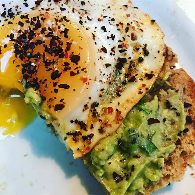 Baked duck egg and mashed avo with coriander, sumac and isot chilli flakes on Mama M's homemade chia and oat bread...... Happy Days Happy Breakfast!!!!!