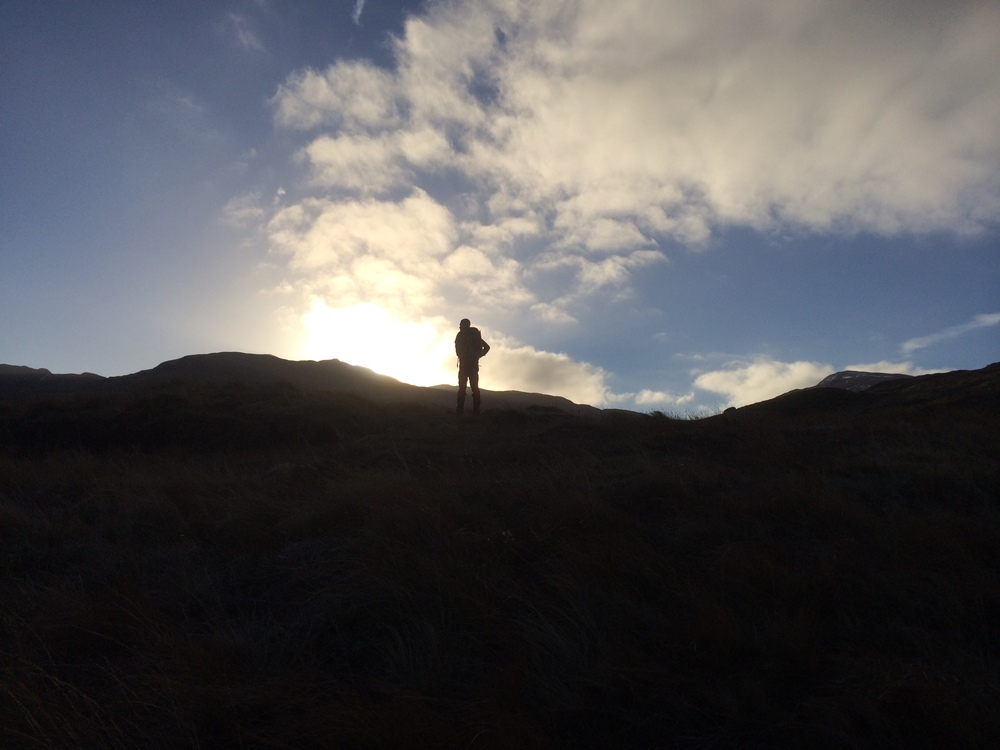 Nigel breaking out of the mountain's shadow and into the winter sun.