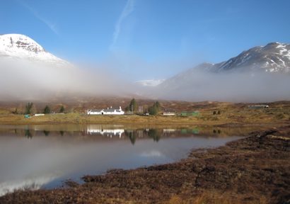 Cluanie Inn flanked by Sgurr an Fhuarail and Am Bathach as the clouds burn off
