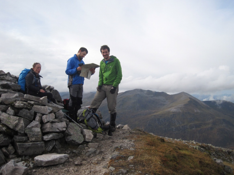 On the summit of Stob Coire Easain, with the peaks of the Grey Corries in the background
