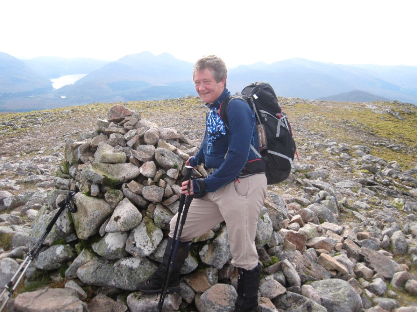 On the summit of Beinn Teallach with yesterday's hills above Loch Treig in the background