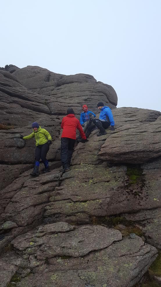 Beinn Mheadhoin dismounting from summit stone