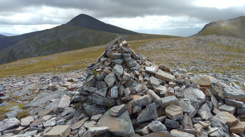 he cairn on the summit of Meall a'Chrasgaidh with Sgurr Mor on the left