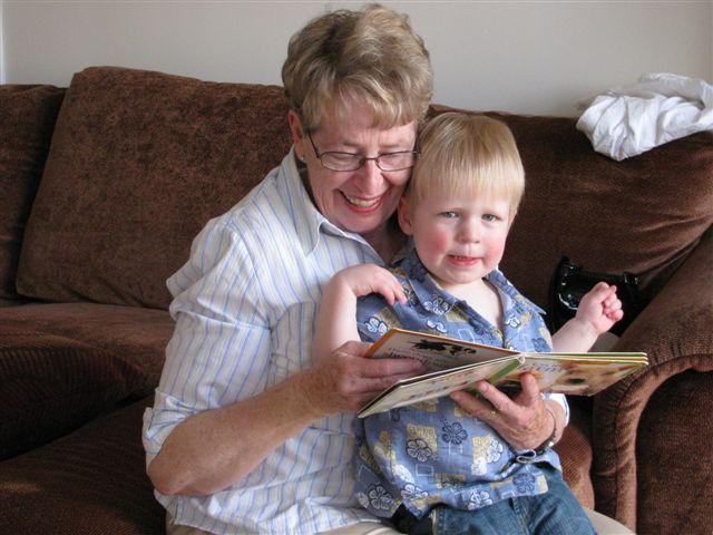 Brandon's 2nd birthday - Grandma took some time to read to him before presents.