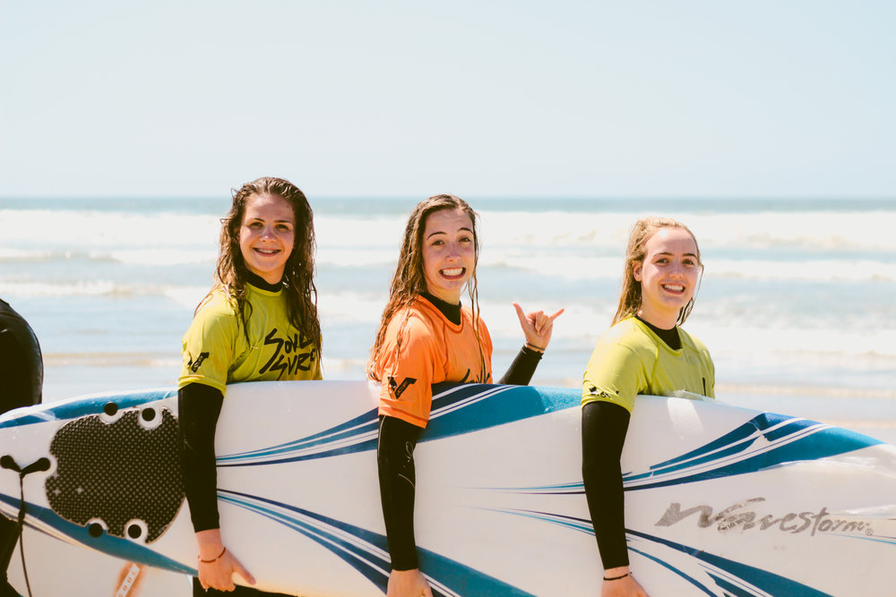 The students get the opportunity to learn how to surf!