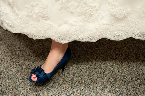 Bride wearing blue shoes