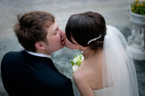 Wedding photograph by Denny Henry of bride and groom kissing in Virginia