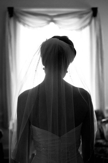 black and white Wedding photograph by Denny Henry of bride getting ready in Virginia