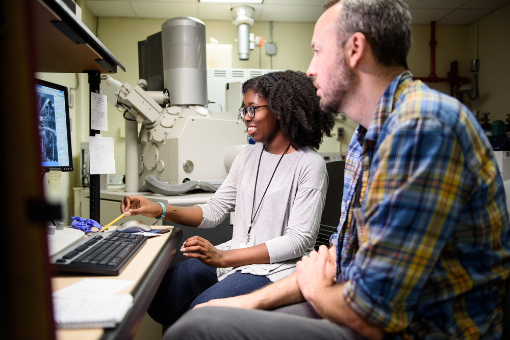 Pomona College student D'Maia Curry works with an electron microscope with her mentor, Dr. Ioan Lascu, at the Smithsonian National Museum of Natural History in Washington, DC.