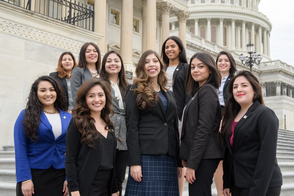 Female interns on the steps of the US Capitol in Washington, DC for the Congressional Hispanic Caucus Institute.