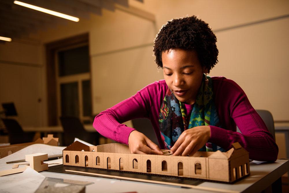 "George Washington University MFA Interior Architecture student Dani MCKenzie works on her project titled ""The Cherry Tree"" in Washington, DC."