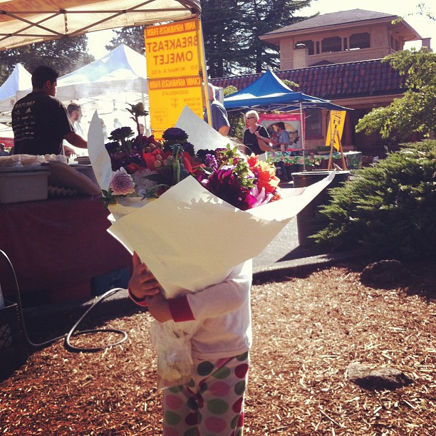 Roza gets some flowers and farmer's market.
