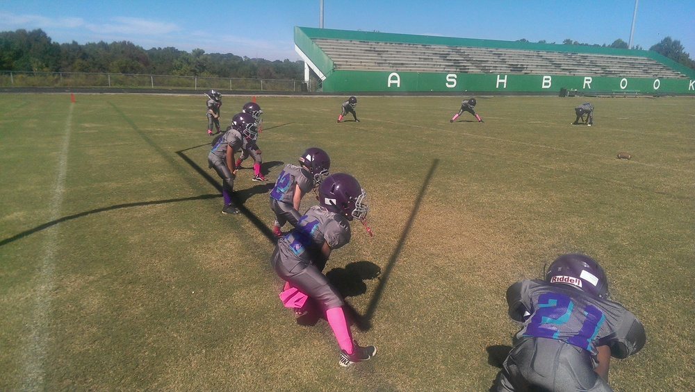 Tiny Mites team warming up and wearing pink  Image credit Ant Pruitt for antpruitt.com
