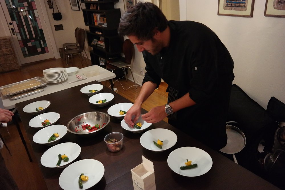 Culinary Hedonism's Chef Peter Calley plating the veggie course