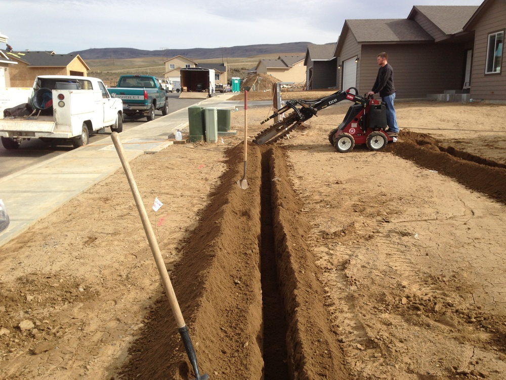 Trenching an East Wenatchee sprinkler system.