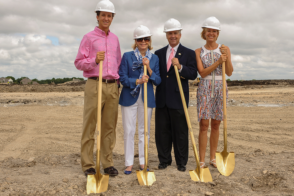 Family Affair: Fin Ewing breaks ground with son Finley, mom Gail, and wife Beth at the groundbreaking ceremony.