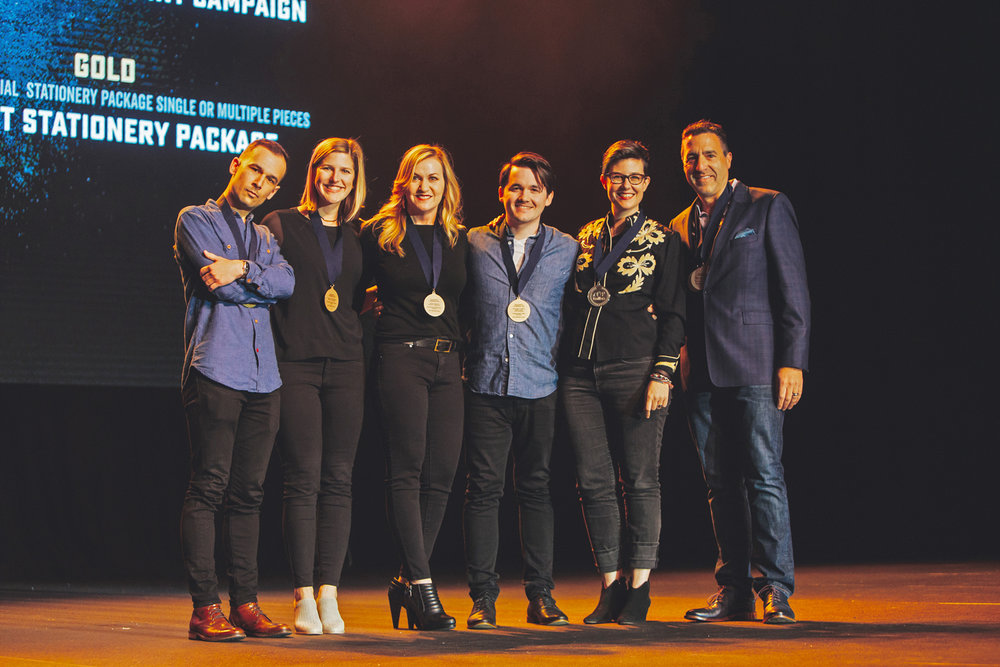 Left to right: Wes Phelan, Senior Designer / Janna Jackson, Account Executive / Kris Murphy, Senior Designer / Ryan Bailey, Senior Designer / Lily Smith+Kirkley, Senior Designer / Leon Banowetz, President + Executive Creative Director