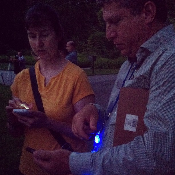 Helpful Longwood employee Joe does an app upgrade on Jen's phone (Taken with  Instagram  at Longwood Gardens)