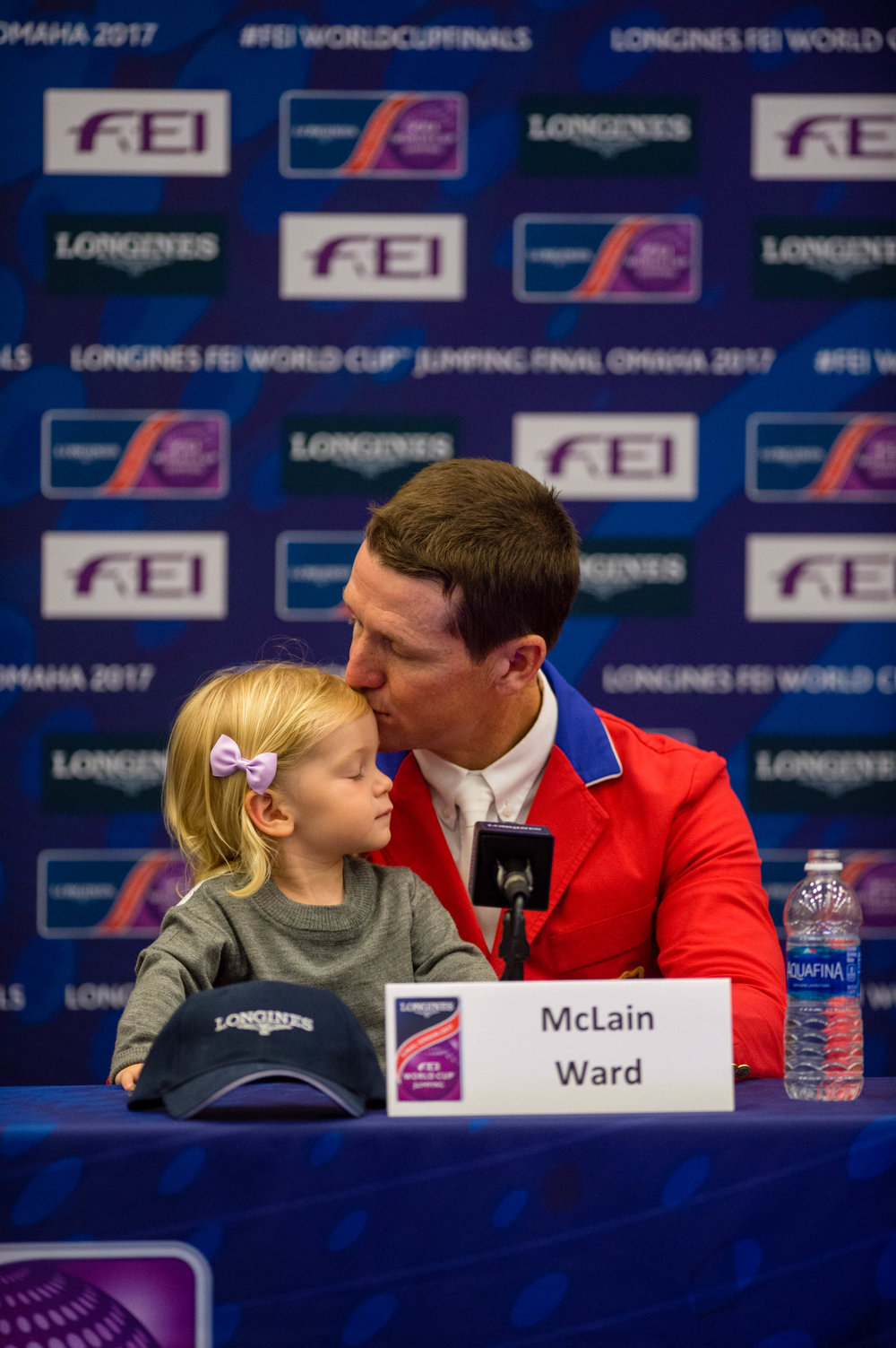 McLain Ward shares a quiet moment with his daughter Lilly during a press conference at the World Cup Finals in Omaha.