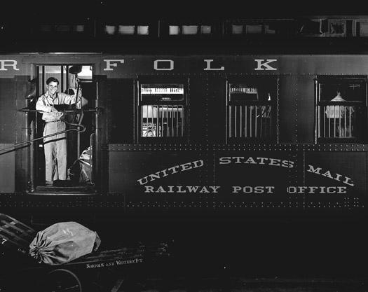 NW1947 Frank Phlegar, Mail Car Postal Clerk, c.1958  16 x 20 inches silver print