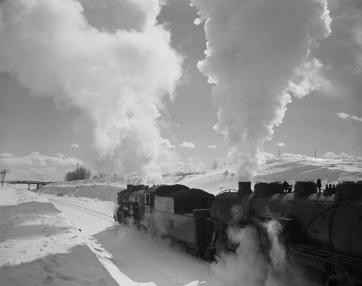 CB&Q daily 2-10-2 and No. 7002 4-8 -2 added at Wyola, MT for the climb up Parkman Hill in Wyoming, 1953  11 x 14 inches vintage silver print