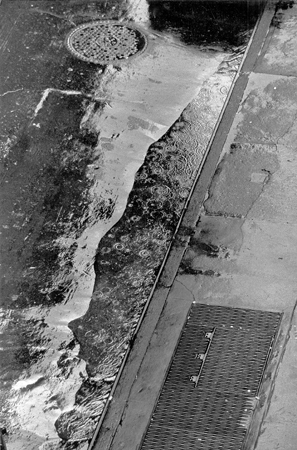 Street & Rain Puddle from 133 West 22nd Street, NYC, 1960  13.25 x 8.75 inches vintage silver print mounted to board
