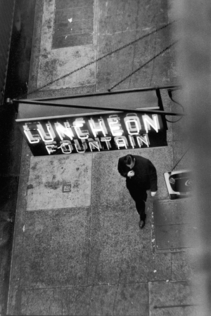 Man Walking Under Neon Sign, West 22nd Street, NYC, 1958  10.75 x 7 inches silver print