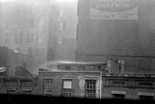 Heavy Rain on Roofs Across Street, from 77 East 10th Street, NYC, 1949  7.625 x 11.25 inches silver print