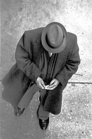 Man with Scrap of Paper, from Above, 133 West 22nd Street, 11/1962  13.25 x 8.875 inches vintage silver print