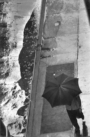 Man with Umbrella, Rain Puddle, from Above, 11 West 22nd Street, NYC, 8/1960  11 x 7.5 inches silver print