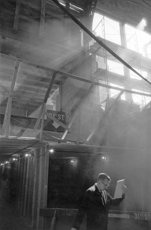 Commuter Entering Penn Station, Under Hole in 31st Street Wall, NYC, 7/1965  13 x 8.25 inches vintage silver print