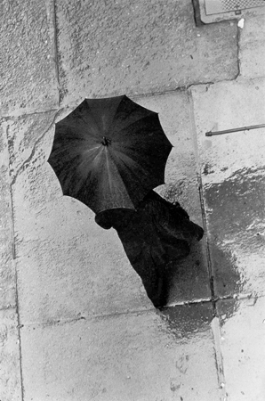Man with Umbrella from Above, 133 West 22nd Street, NYC, 1960  11.5 x 7.375 inches vintage silver print
