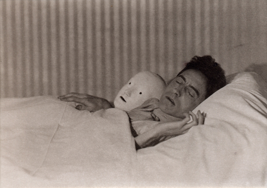 Berenice Abbott Cocteau in Bed with Mask, Paris, France, 1927 3.13 x 4.25 inches palladium print